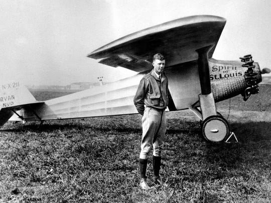 Charles A. Lindbergh poses with his plane 'The Spirit