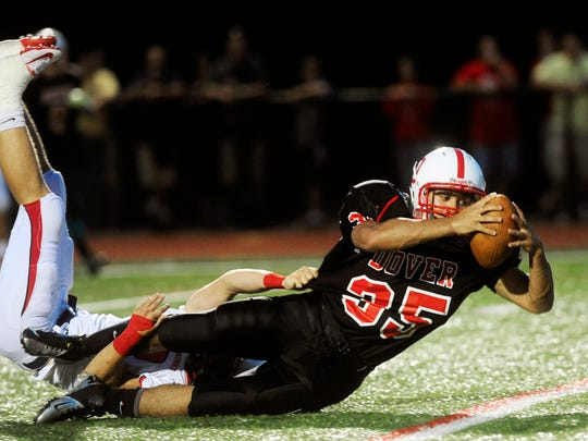 Dover's Isaiah Green is brought down by a Red Land defender in 2012. Green was killed by police early Thursday morning after he allegedly approached an officer while carrying an AR-15 rifle.