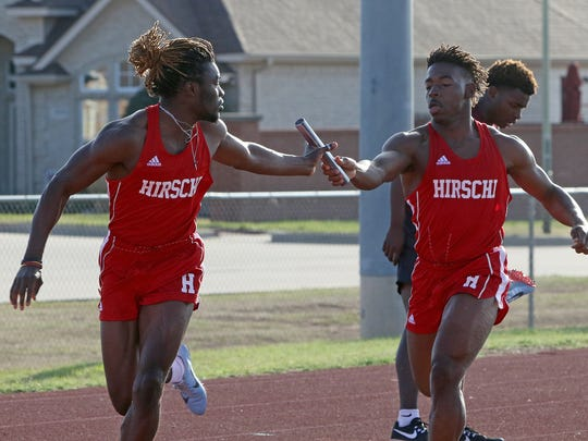 Hirschi's Daimarqua Foster hands the baton to Gerrick McKinney in the 4x200 relay Thursday, March 22, 2018, in the Hirschi Huskies Invitational track meet at Garnett Stadium. The Huskies finished first with a time of 1:29.27.