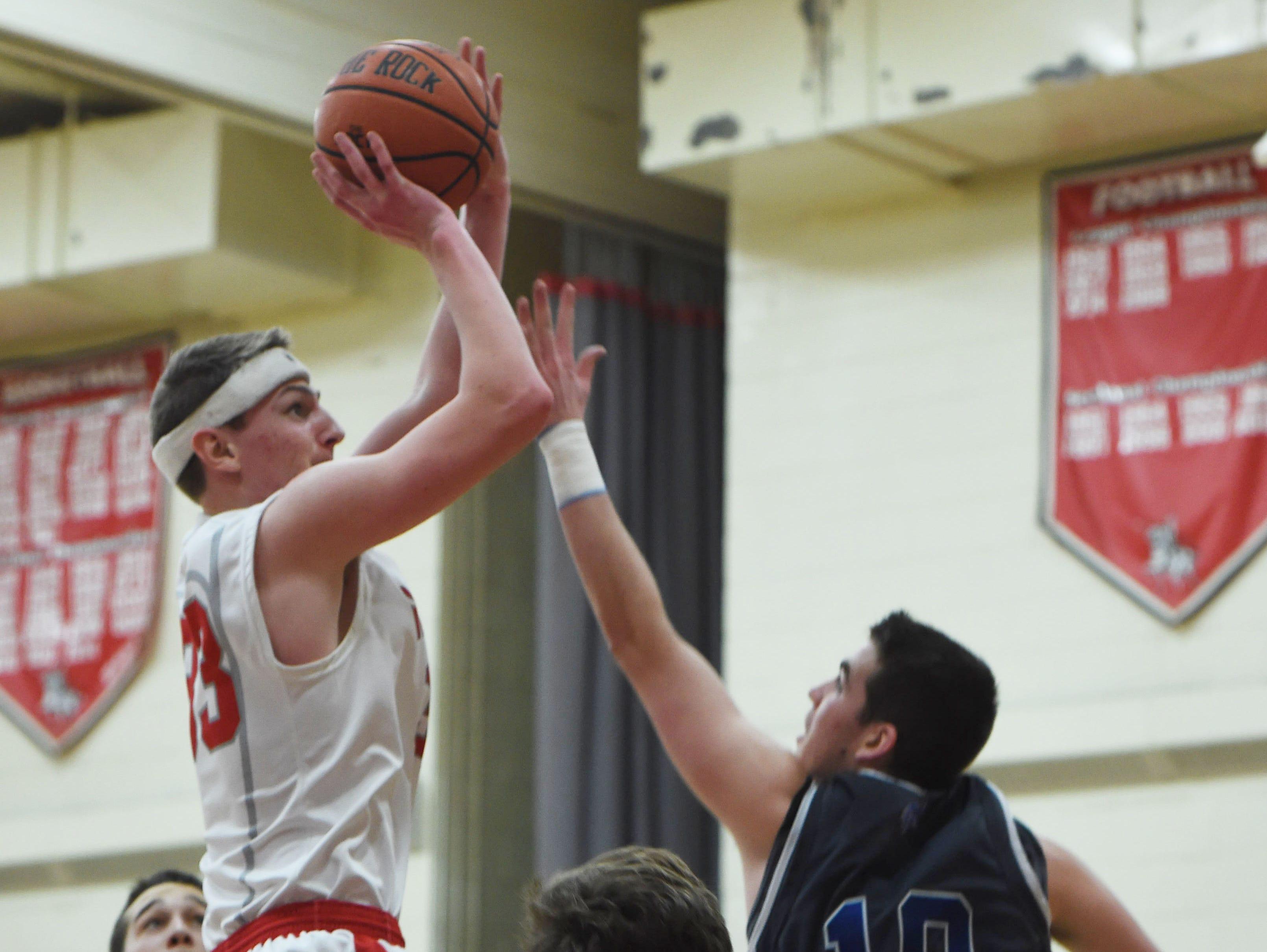 Red Hook High School's Colin Bemis takes a shot against Valley Central at Red Hook on Jan. 16.