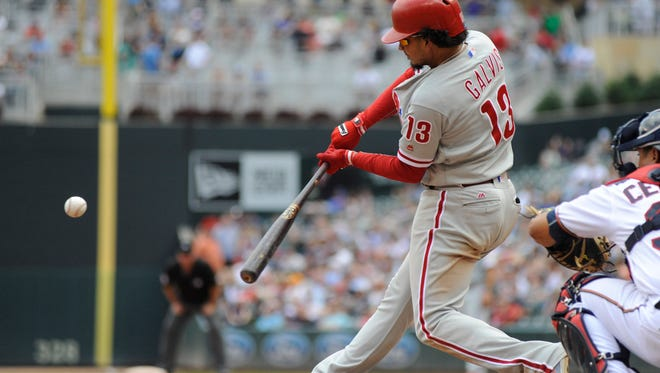 Phillies shortstop Freddy Galvis hits a three-run homer during the eighth inning against the Minnesota Twins at Target Field. The Phillies finished with a season-high 15 hits in a 7-3 win over the Twins to snap a nine-game losing streak.