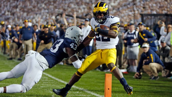 Karan Higdon #22 of Michigan rushes for a 1 yard touchdown against Manny Bowen #43 of Penn State on Saturday, October 21, 2017 at Beaver Stadium in University Park, Pa.