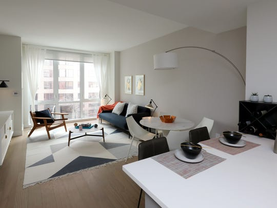 The living area in a one bedroom apartment at Continuum,