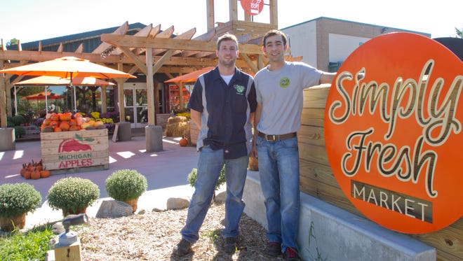 Nick Gelardi, left, and his brother Anthony run Simply Fresh Market in its new location in Genoa Township.