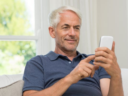 Retired man texting