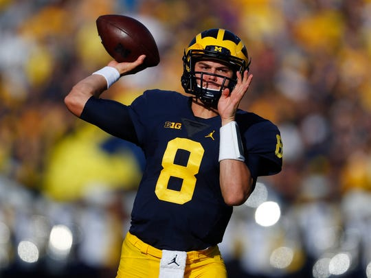 Michigan Wolverines quarterback John O'Korn throws before the first half against Maryland in Ann Arbor on Nov. 5, 2016.