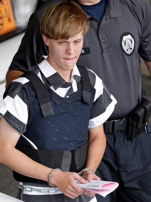 The Charleston, S.C., shooting church suspect, Dylann Storm Roof, is escorted June 18, 2015, from the Cleveland County Courthouse in Shelby, N.C.