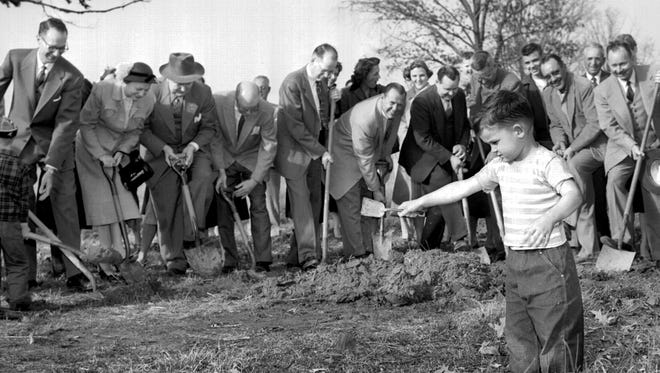 February 21, 1954 - To break ground for construction of a manse, members of the new Woodland Presbyterian Church thought it would be a great idea if everyone brought his own shovel. Randy Myers agreed. The 3-year-old son of Mr. and Mrs. S.R. Myers of 4536 Flamingo showed up with his sand shovel for the ceremony in February 1954. The three-bedroom pastor's home will rise on Kings Park Lane south of Crossover Lane. Soon to be occupied is the church unit on Park east of Mt. Moriah Road.
