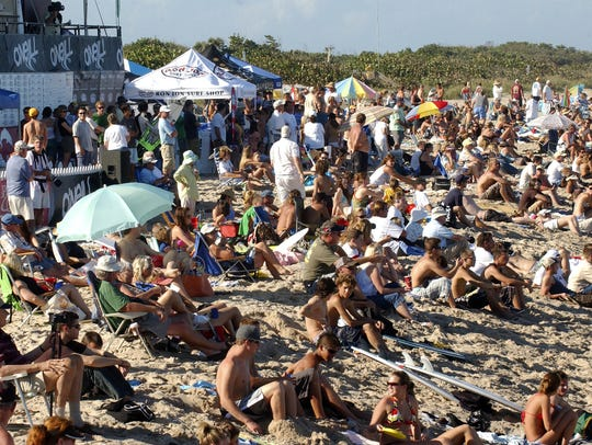 Crowds pack the beach at Sebastian Inlet State Park