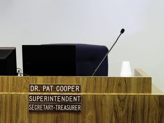 Dr. Pat Cooper's seat in the school board office is pictured following his disciplinary hearing Thursday, November 6, 2014, at the Lafayette Parish School Board office in Lafayette, La.