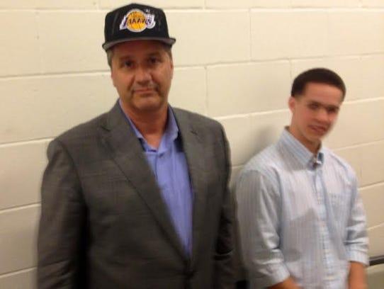 John Calipari in a Lakers hat