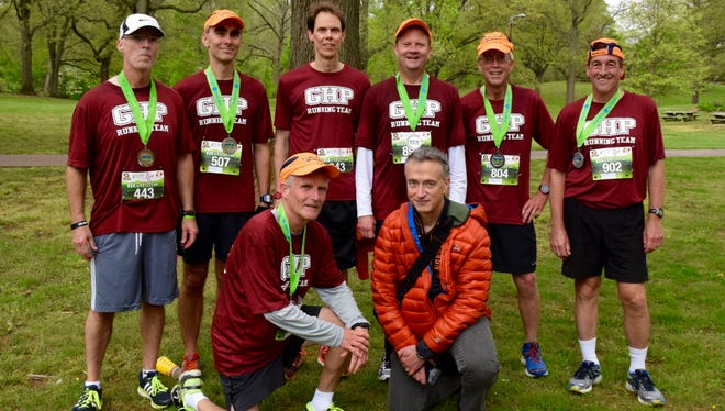 Members of the Gypsy Hill Park Running Club pose for a group photo after running the Park-to-Park Half Marathon at Ridgeview Park in Waynesboro on Saturday, April 30, 2016. Front, from left, Gary Michael, Kerry Alexander; back, from left, Jimmy Atkins, Paul Callo, John Geigel, Eric Pritchett, Larry Mancini, Doug Riley