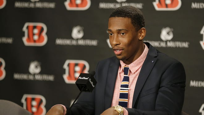 Cincinnati Bengals safety George Iloka talks in a press conference after signing his new contract at Paul Brown Stadium in downtown Cincinnati, on March 10.