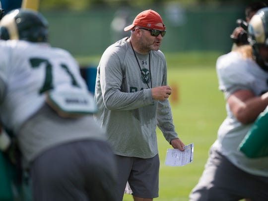CSU offensive coordinator Will Friend instructs the