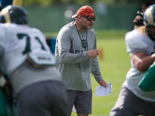 CSU offensive coordinator Will Friend instructs the offensive line during practice Wednesday, August 10, 2016.
