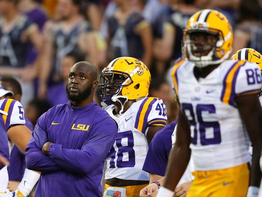 FILE - In this Sept. 10, 2016, file photo, LSU running back Leonard Fournette, left, watches players warm up for an NCAA college football game against Jacksonville State in Baton Rouge, La., Fournette did not play in the game. Regardless of how much Fournette plays, the No. 20 Tigers remain optimistic about their prospects for gaining yards on the ground against Mississippi State. LSU sophomore Derrius Guice rushed for 155 yards in his first-career start last weekend, when Fournette sat out to rest his bruised left ankle. (AP Photo/Gerald Herbert File)