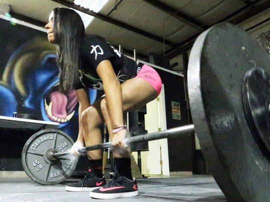 Arianna Aguilar performs deadlifts during a recent