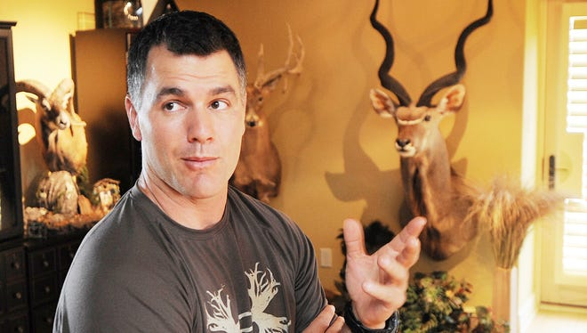 Colts kicker Adam Vinatieri has a love for hunting ... big game hunting. His office in his Carmel home is decorated wall to wall with his hunting trophies.