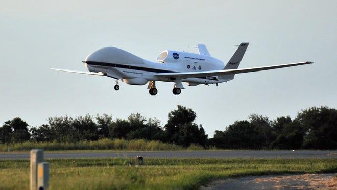 Global Hawk lifts off a runway at NASA's Wallops Flight Facility.