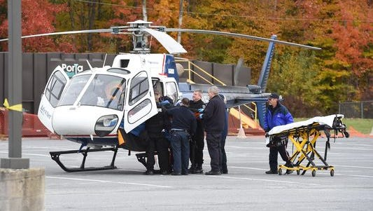 John Tozzi was taken by ambulance to New Paltz High School, then transported by helicopter to a local hospital in October after a standoff with police left him with a gunshot wound to the chest.
