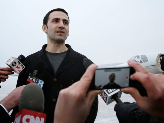 Former U.S. Marine Amir Hekmati, 32, talks to the media after arriving at Bishop International Airport on Thursday, Jan.  21, 2016, in Flint,.