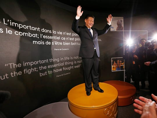 Chinese President Xi Jinping stands on the podium of
