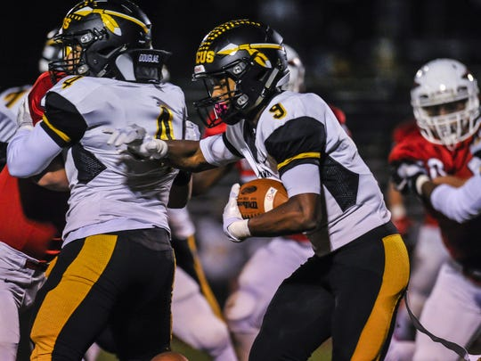 Piscataway running back Juwon Jackson battles for yards during a game on Friday against Manalapan in Manalapan on Oct. 27, 2017.
