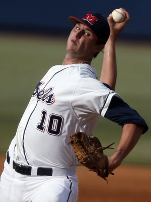 Mississippi pitcher Chris Ellis throws against Jacksonville State during the third inning of an NCAA college baseball regional tournament game in Oxford, Miss., Saturday, May 31, 2014. (AP Photo/Rogelio V. Solis)