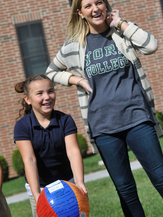 Akasha Overton, left, a student from Lincoln Charter School, tosses a beach ball with questions on it during an ice breaker at York College on Friday, Oct. 16, 2015. Lauren Balcerak, right, a freshman at the college with the group Enactus, was part of a training seminar for students from the charter school, teaching them about respect.  Jason Plotkin - York Daily Record/Sunday News