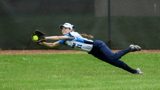 Regina outfielder Megan Ross makes a diving catch to rob Mercy's Grace Nieto of a hit in the first inning