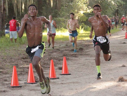 The battle for third place in 5K with Christopher Porter