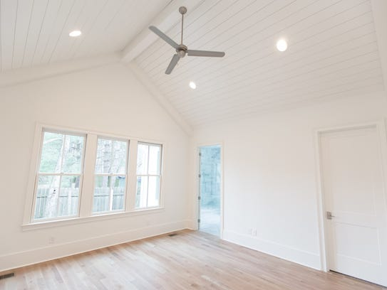 Vaulted shiplap ceilings lend a sense of rustic coziness