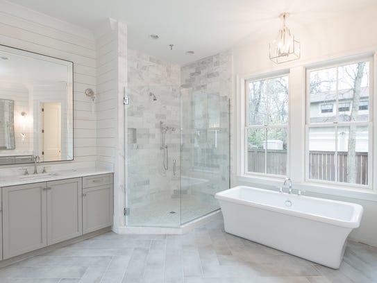 The master bath boasts a deep, rectangular soaking