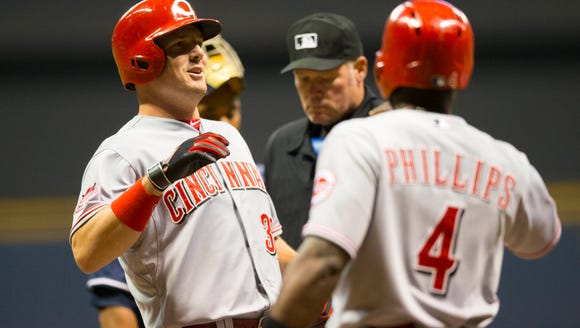 Reds right fielder Jay Bruce (left) celebrates with