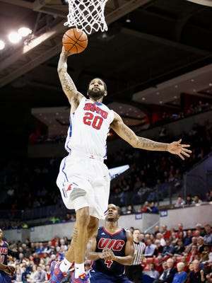 SMU forward Justin Martin dunks the ball in front of Illinois-Chicago Flames guard Lance Whitaker on Dec. 17.