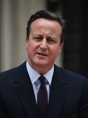British Prime Minister David Cameron delivers a speech outside 10 Downing Street on May 8.