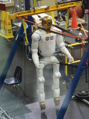 The robotics lab at the Johnson Space Center is one stop on the itinerary for the summer program.