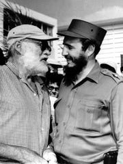 Author Ernest Hemingway (left) and Cuban Prime Minister Fidel Castro exchange pleasantries at seaside after Castro won the individual championship in the annual Hemingway Anglers Tournament on May 15, 1960.  Castro caught five fish weighing 286 pounds to take the crown. Hemingway had a bad day failing to land any.