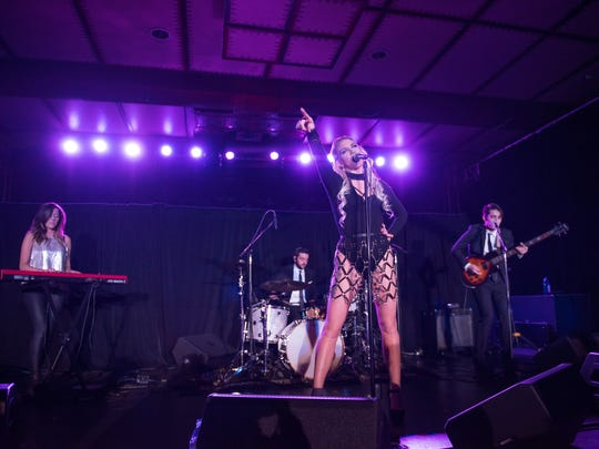 Zoe LaBelle (center) opens for York rock band Live