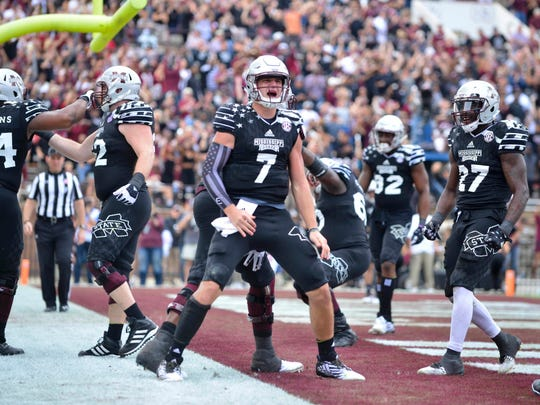 Mississippi State Bulldogs quarterback Nick Fitzgerald (7) celebrates with teammates after a touchdown in the third quarter against the Texas A&M Aggies at Davis Wade Stadium. Mississippi State won 35-28. Mandatory Credit: Matt Bush-USA TODAY Sports