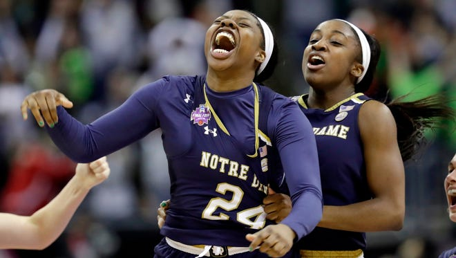 Notre Dame's Arike Ogunbowale is congratulated by teammate Jackie Young after sinking a three-pointer in the final second Sunday to defeat Mississippi State, 61-58, for the women's NCAA title.