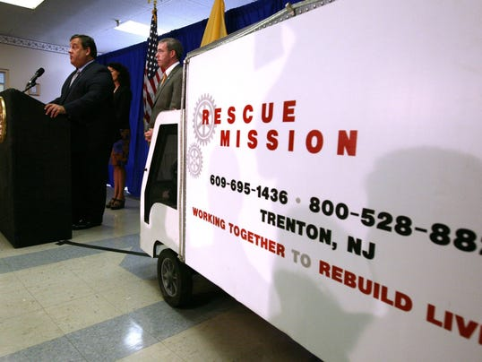 Gov. Chris Christie signed the drug-courts expansion bill at the Rescue Mission of Trenton in July 2012. (Governor's Office/Tim Larsen)