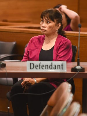 Defendant Frances Quinata listens to instructions from Superior Court of Guam Judge Michael Bordallo during her court appearance at the Guam Judicial Center in Hagåtña on Thursday, Jan. 19, 2017.