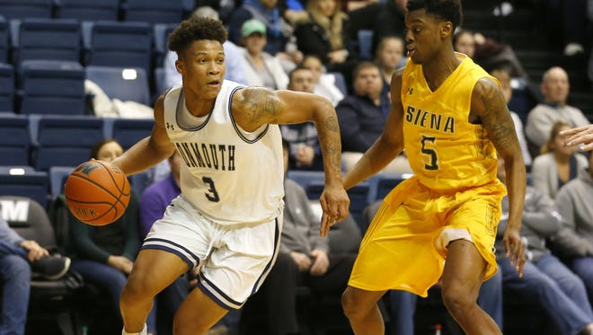Monmouth Hawks guard Deion Hammond (3) drives to the basket against Siena Saints guard Kadeem Smithen (5) during second half at Ocean First Bank Center.