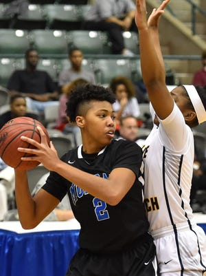 Murrah's Jamaica Almons (2) looks to pass against Olive Branch during MHSAA 6A Girls Semifinal action held March 8th, 2017 at the Mississippi Coliseum in Jackson, MS. (Bob Smith-For The Clarion Ledger)