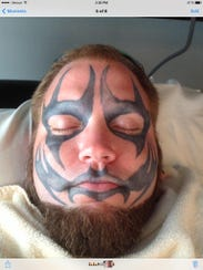 Photo of Coon's face tattoo.