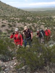 Mesilla Valley Search and Rescue members hike up the