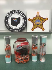 Syringes found during a Galion drug bust are displayed