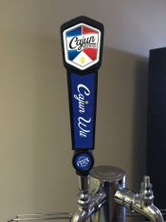 The folks at Cajun Brewing make their own tap handles