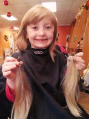 Jenni Creamer of Vineland also donated her long hair